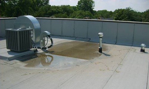 Standing water on flat roof